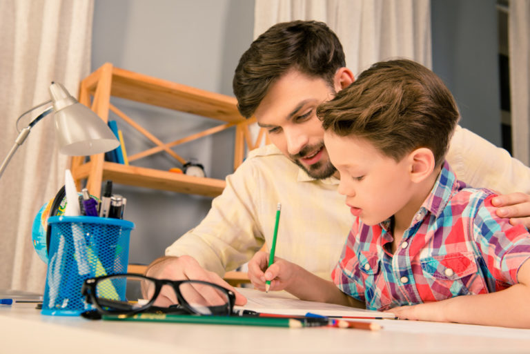 father and son studying