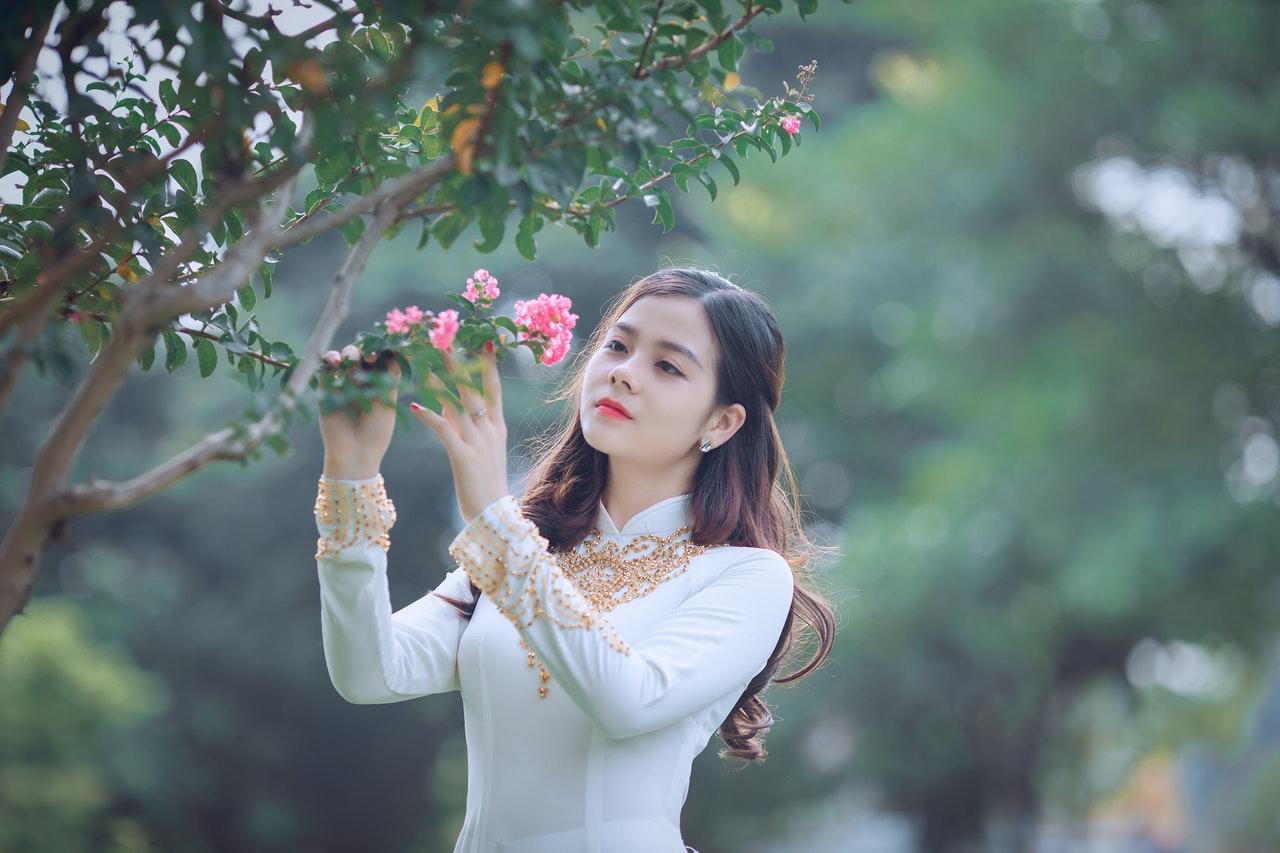 asian woman model holding flower