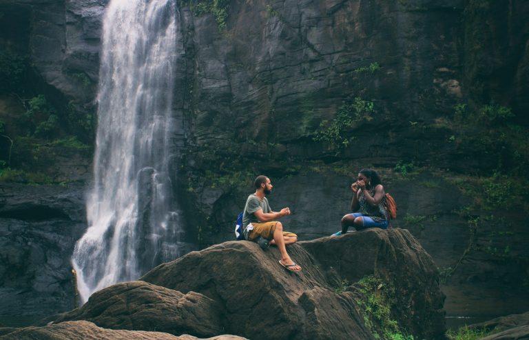 people near a waterfall