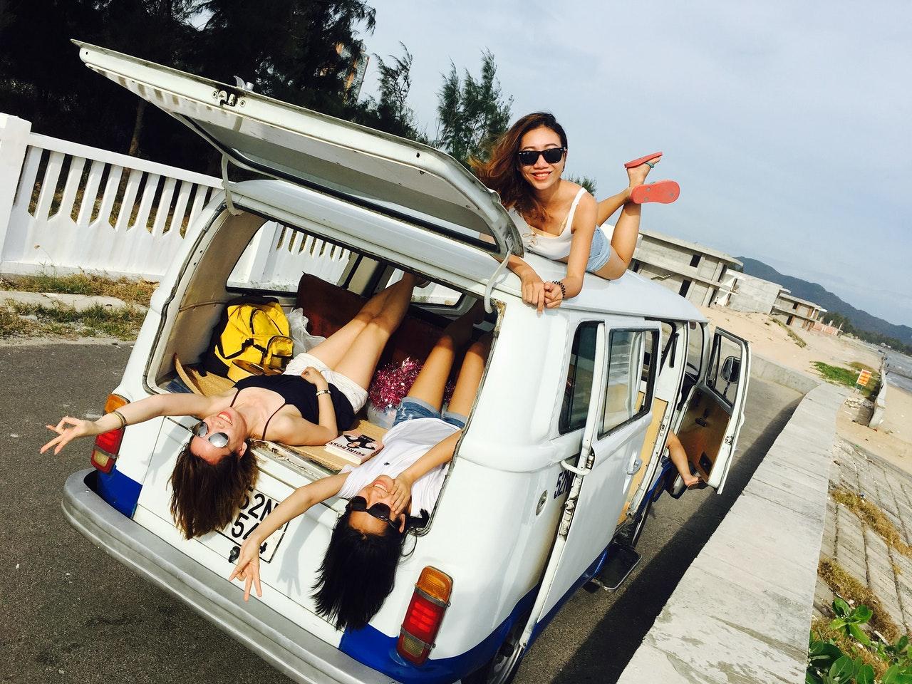 women on a minivan